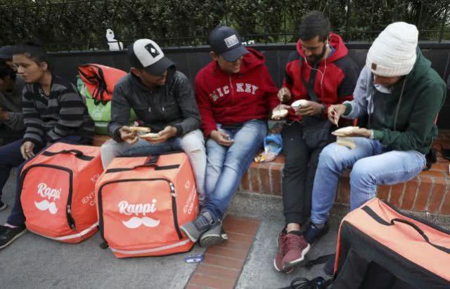 委内瑞拉移民在哥伦比亚送快递,骑手催生数十亿美元价值应用程序